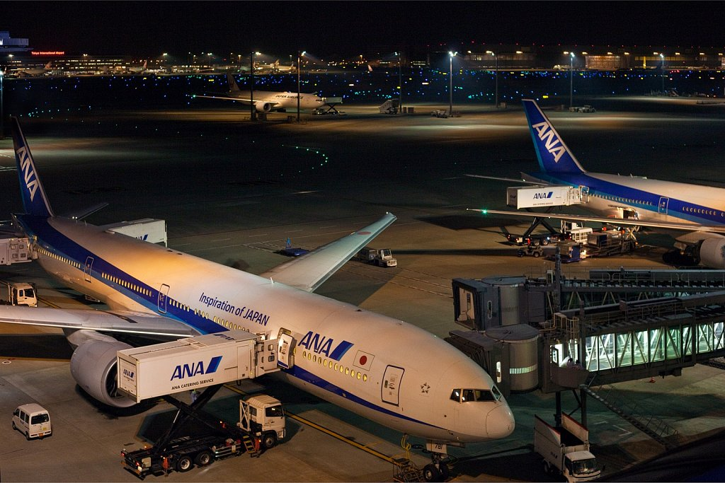 Aircraft loading at the gate in the evening at Haneda Airport, Tokyo, Japan