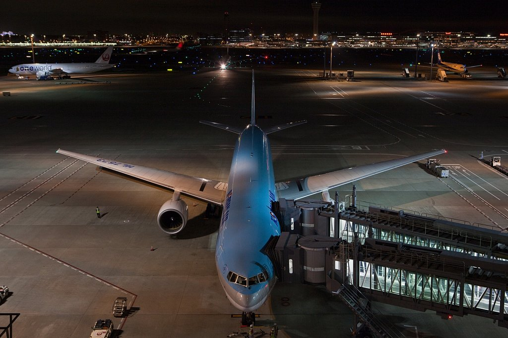 Airliners loading and taxiing at night, Haneda Airport, Tokyo, Japan