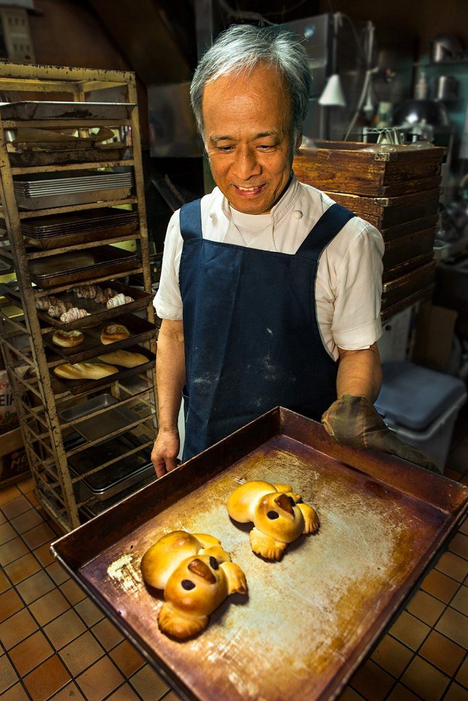 Baker with pan of koala bear bread in Nakaikegami, Tokyo, Japan