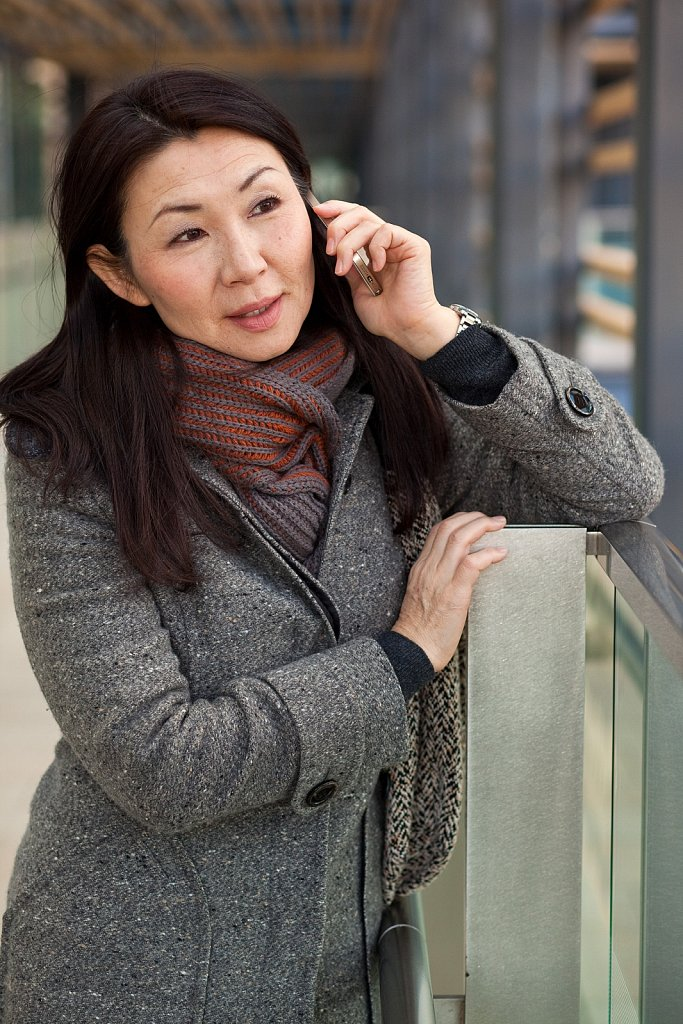Business woman uses cell phone in Roppongi, Tokyo, Japan