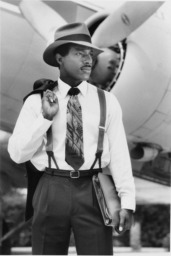 Model as 1940's era traveling gentleman