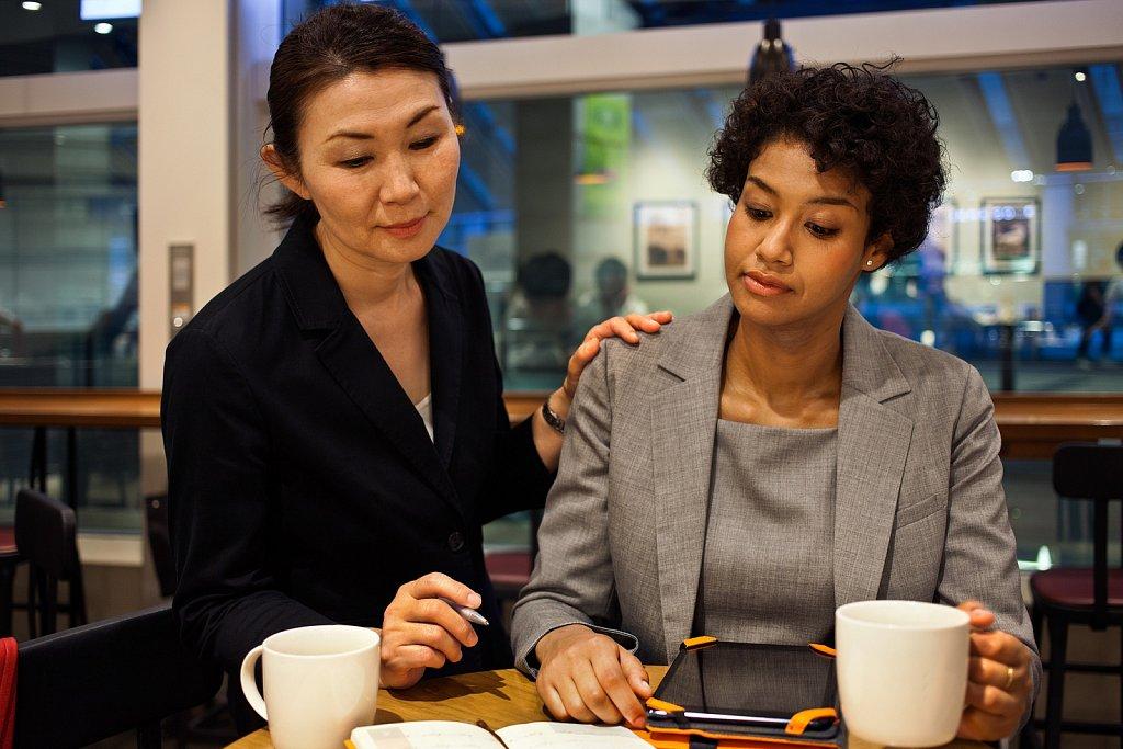 Senior and junior women co-workers meeting in Shinagawa, Tokyo, Japan