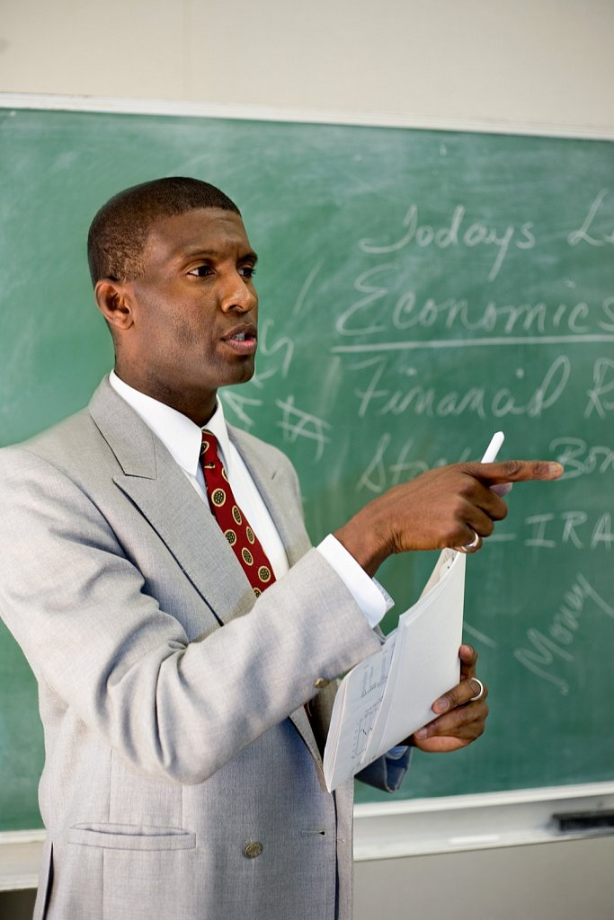 African American high school teacher at blackboard