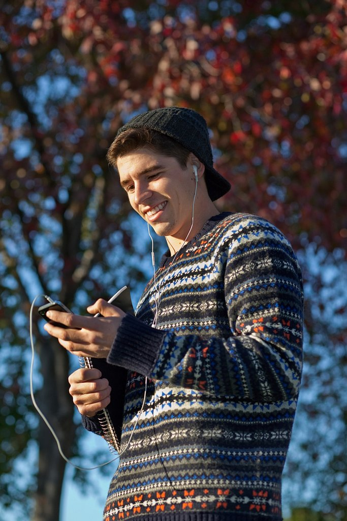 College student with phone at autumn