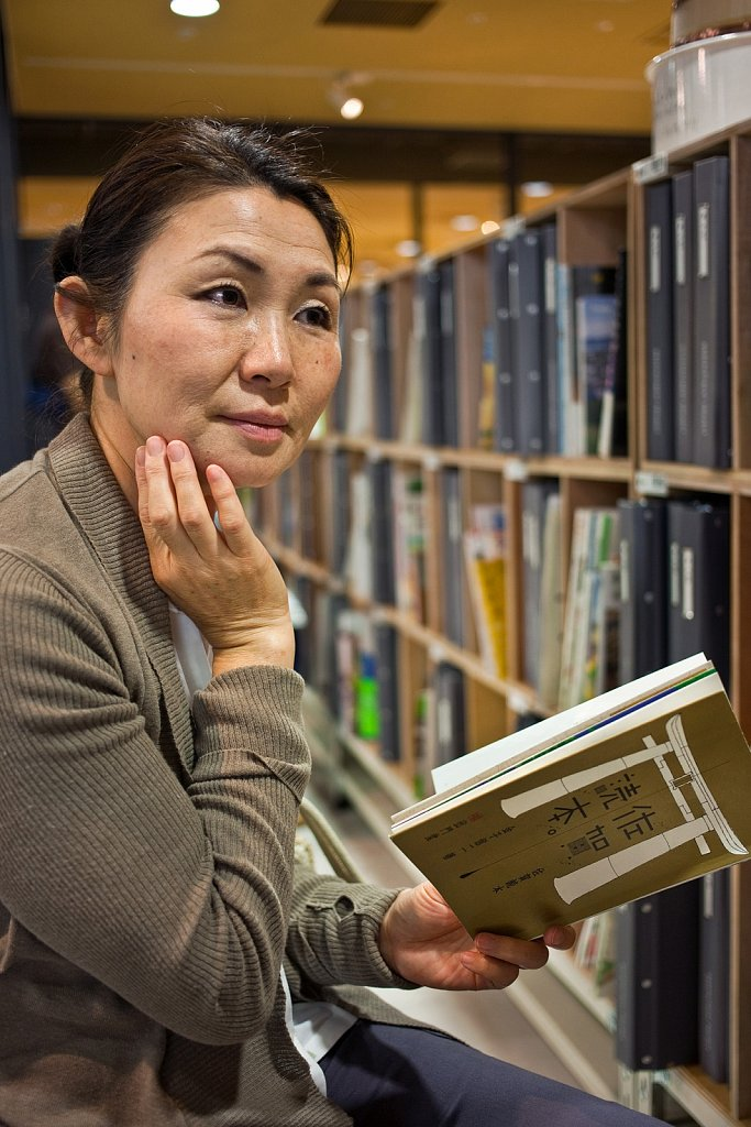 Woman in thought at bookstore in Shibuya, Tokyo, Japan