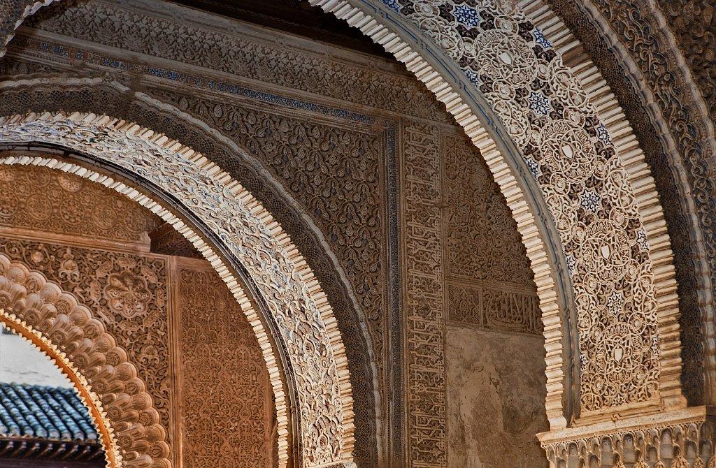 Arabesque plaster walls and arches, 14th century, The Alhambra, Granada, Spain