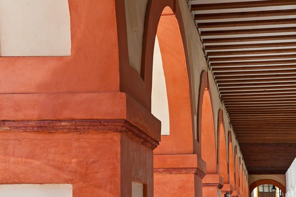 Arches in corridor at Plaza Corredera in Old Quarter, Cordoba, Spain
