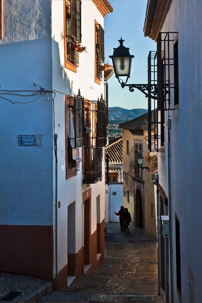 Narrow hillside street in Granada