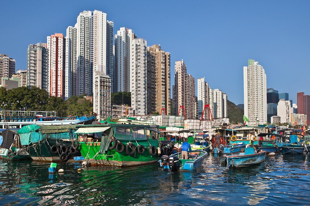 Boats in harbor and high rise residences in Aberdeen, Hong Kong, China