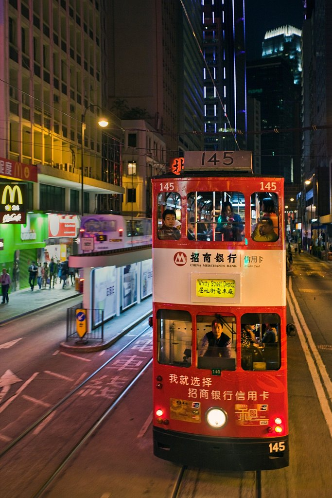 Double-decker tram in the evening on Hong Kong Island, China