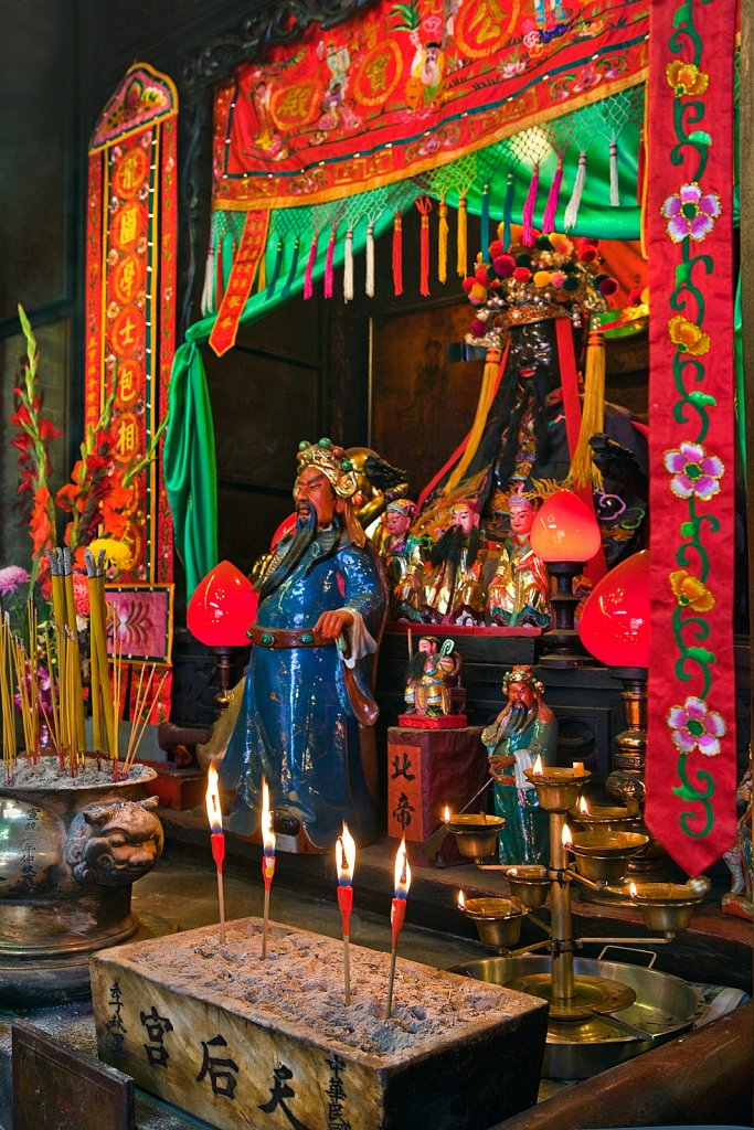 Incense candles and statues at altar at Tin Hau Temple in Kowloon, Hong Kong, China
