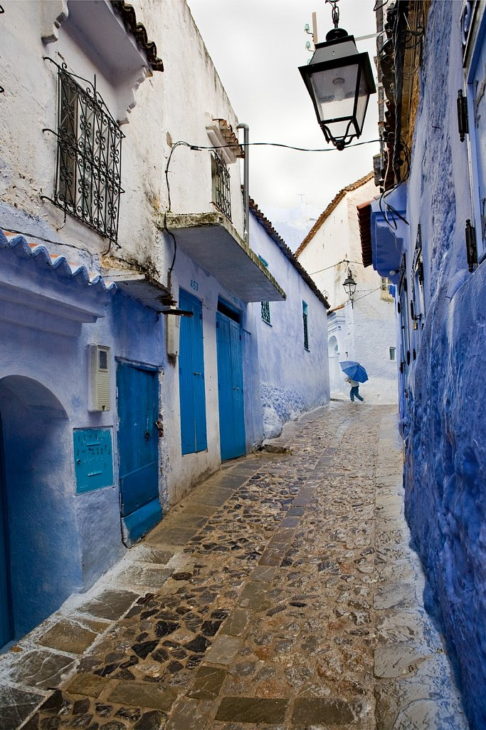 Narow street in rain, Chefchaouen, Morocco