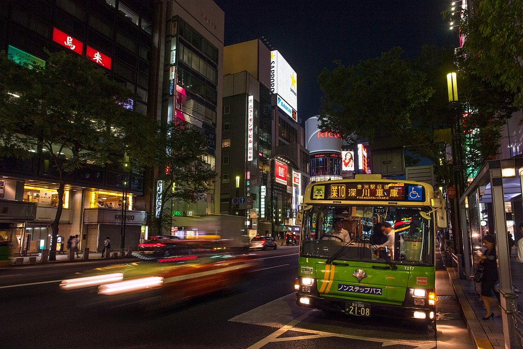 Bus and Taxi traffic in the evening in Ginza, Tokyo, Japan
