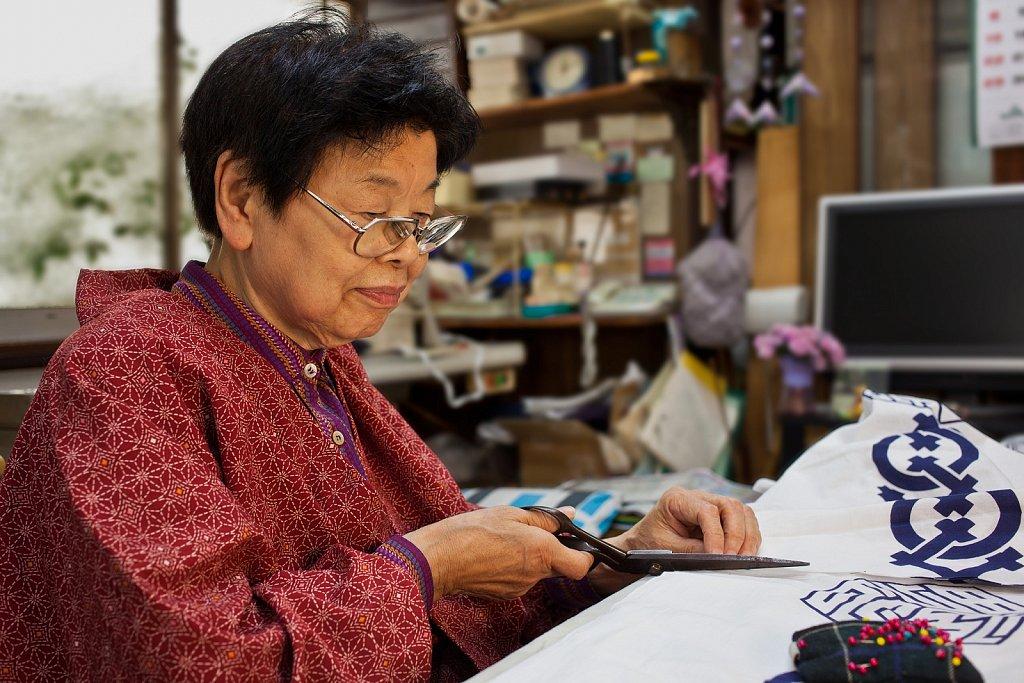 Seamstress makes yukata in her shop in Kamiikedai, Tokyo, Japan