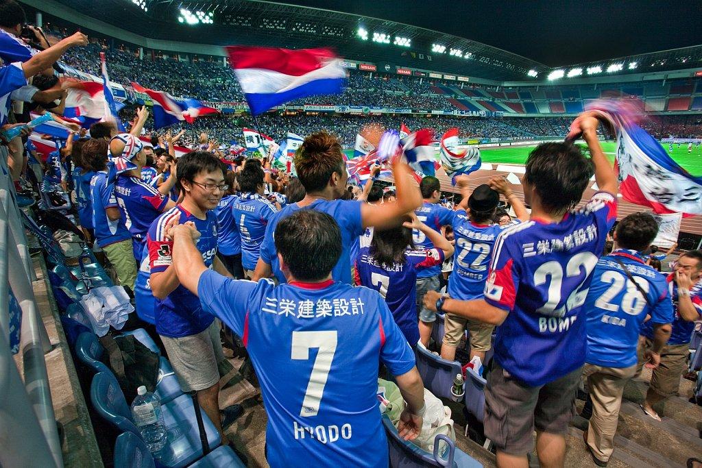 Soccer fans celebrate goal at Nissan Stadium, Yokohama, Japan