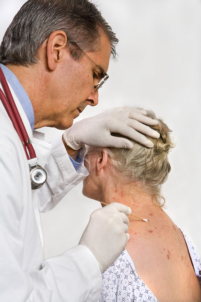 Dermatologist with patient