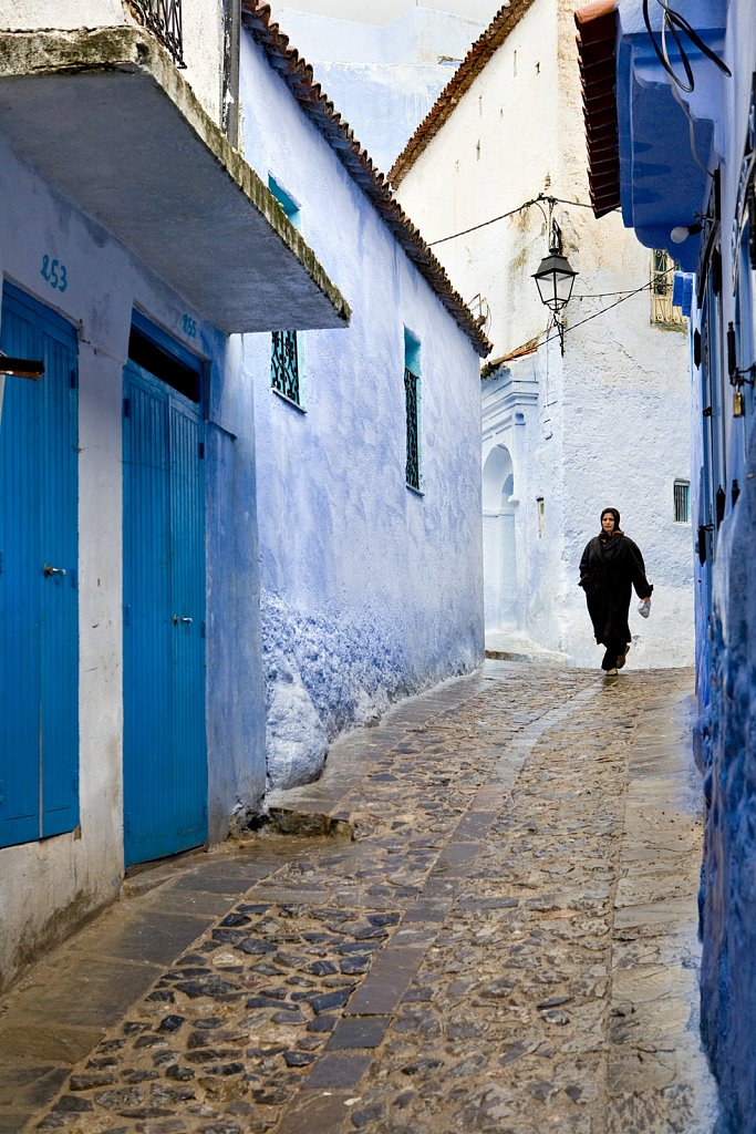 Woman in traditional jabala in Chefchaouen, Morocco